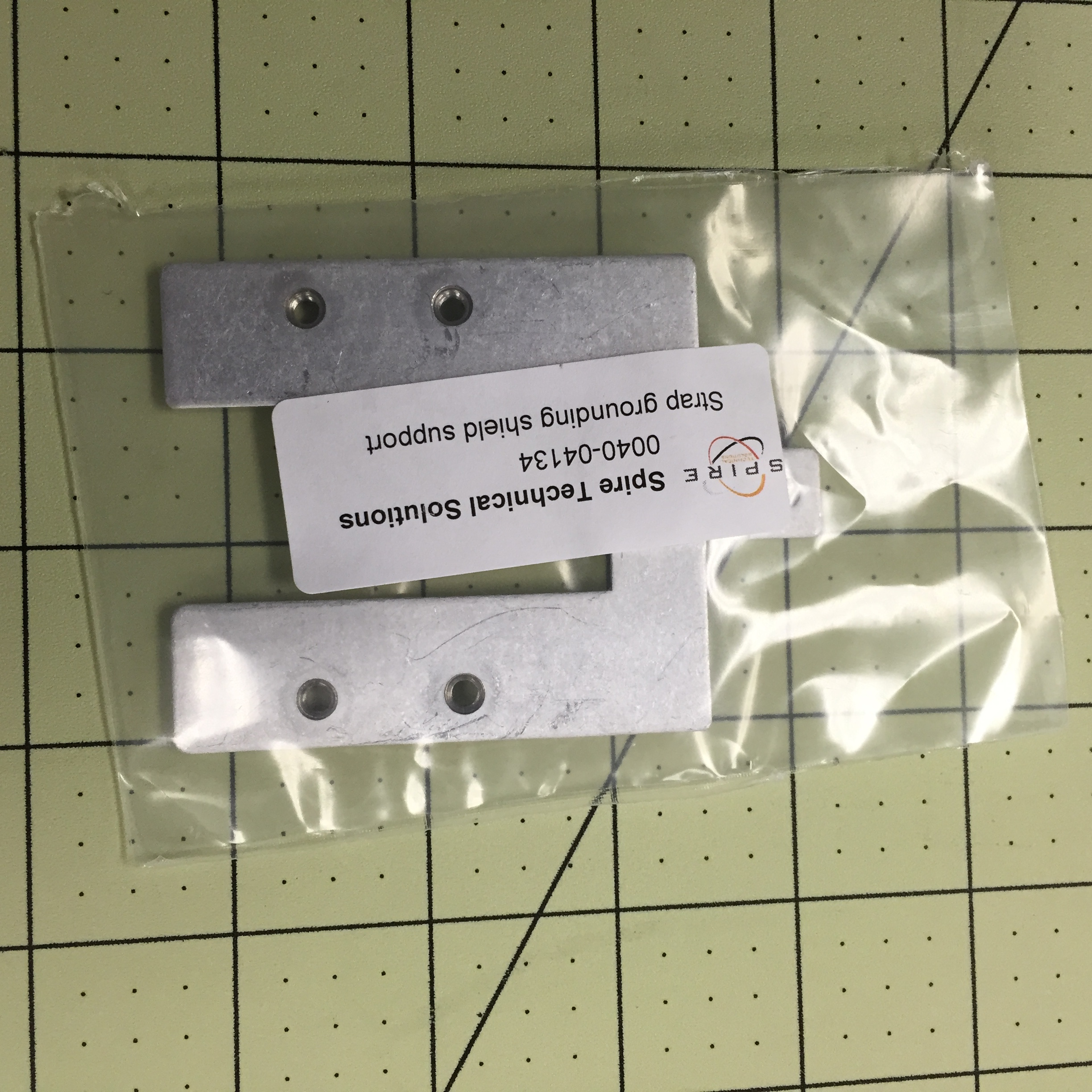 Strap grounding shield support